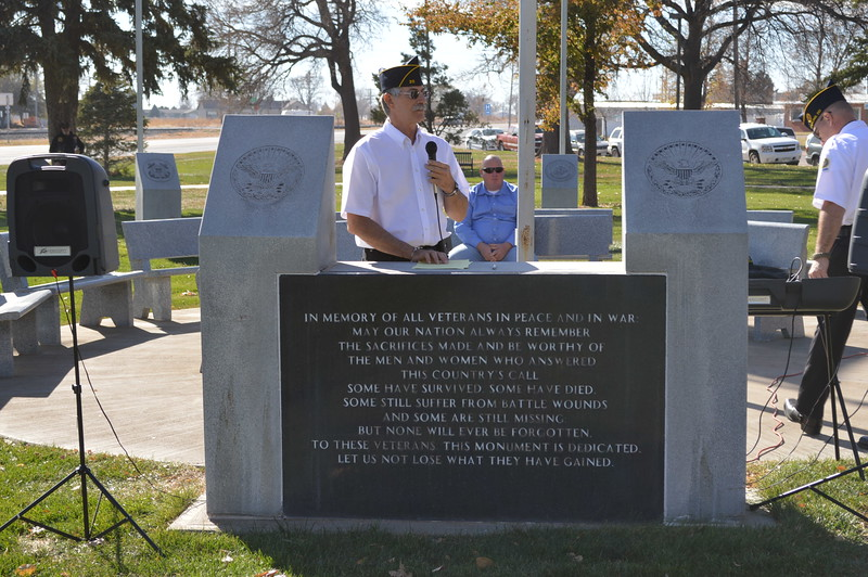 Joe Notario, Commander of the Sterling American Legion post, addresses the crowd gathered at the Veterans Memorial in Columbine Park for the 2016 Veterans Day service Friday, 11.11.16.