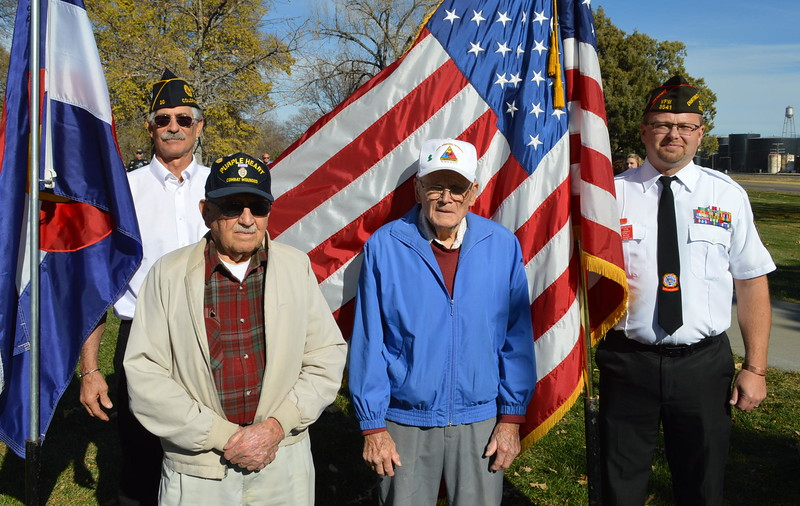 The Hon. Baxter Arnold, second from left, and George Gay were the only two World War II veterans who answered the call for photos after Friday's service. At left are Joe Notario, Commander of the Sterling American Legion post, and, at right, Lonnie Brungardt, Legion District 4 commander.