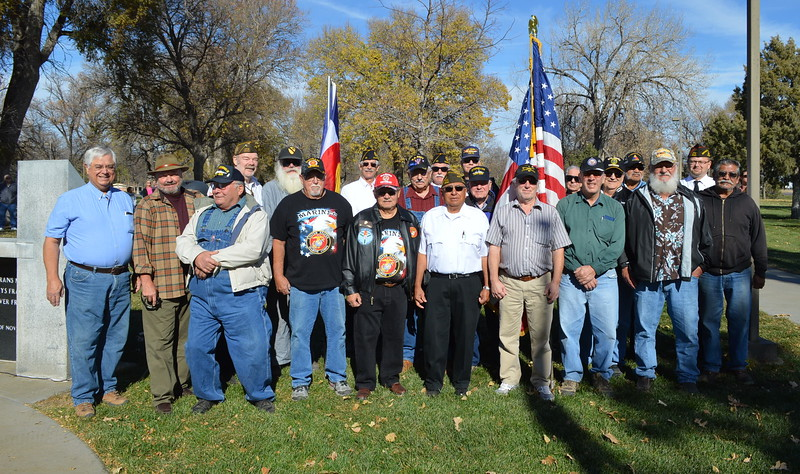 Veterans gather for a group photo following the Veterans Day service Friday, Nov. 11, 2016.