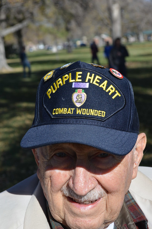 Baxter Arnold wears a hat reflecting his military honors from his time in the service during the 2016 Veterans Day service at Columbine Park in Sterling, Colo. (Jeff Rice/Journal-Advocate)