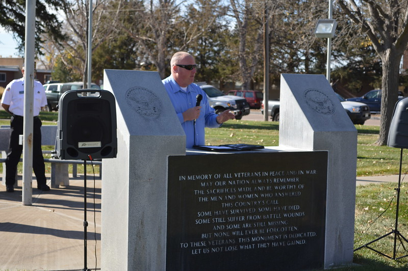 Benjamin McLoughlin delivers keynote remarks during Friday's Veterans Day observation at Columbine Park.