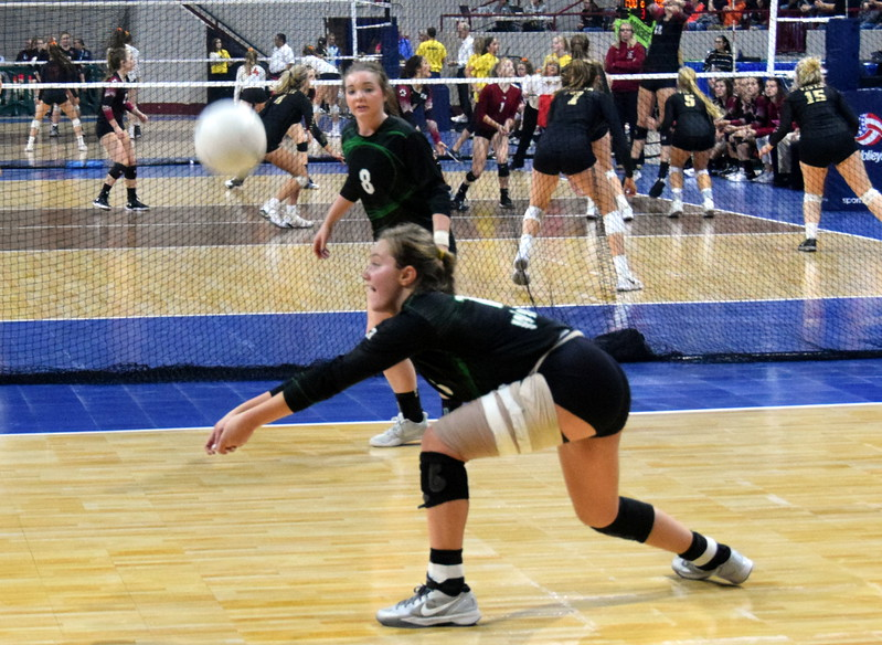 Alli Keisel get low to keep a ball from hitting the floor at the 1A state tournament on Saturday.