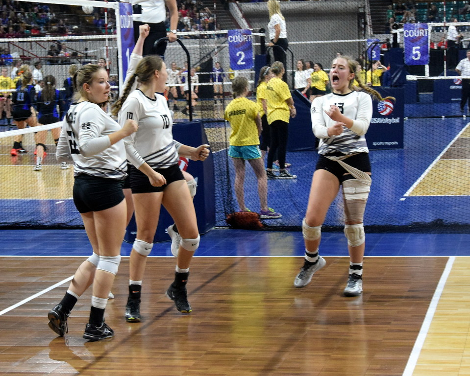 (from right) Brooke Sigmon, Kendyl Kirkwood, and Alli Keisel react after Fleming scores a point.