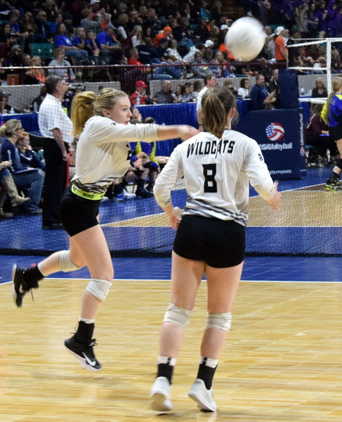 Hannah Blom receives a serve in the Fleming Wildcats pool-play win on Friday.