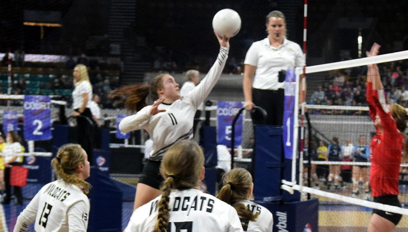 Bailey Chintala rises up to tap the ball over the net on Saturday in Denver.