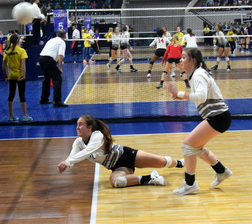 Bailey Chintala dives to keep a ball from hitting the ground.
