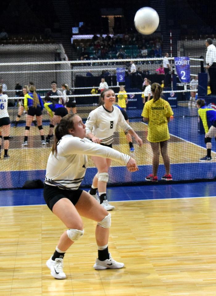 Bailey Chintala receives a serve while Jenna Lengfelder looks on.