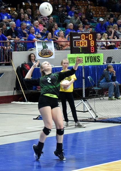 Hannah Blom focuses on her serve attempt during pool play at the Denver Coliseum.