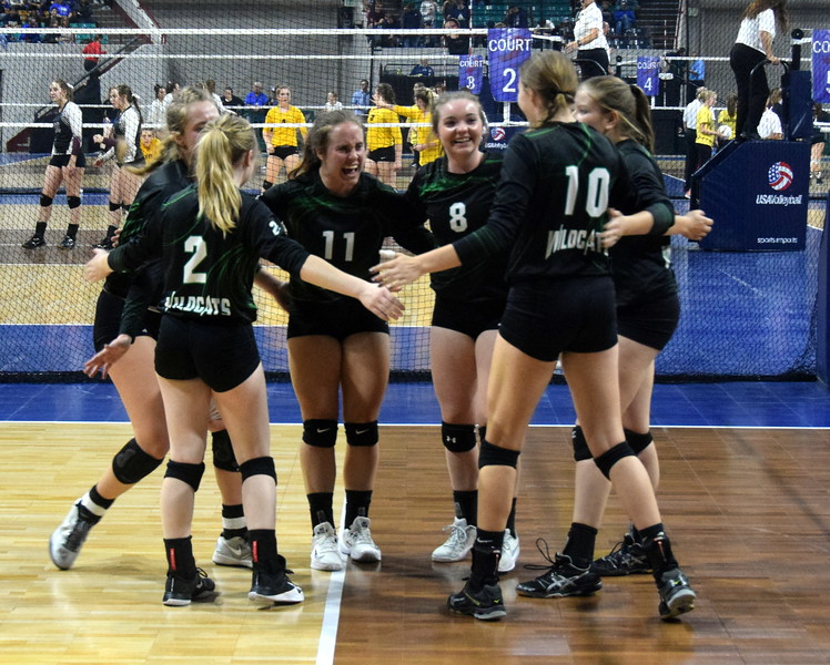 The Fleming Wildcats pump themselves up in Denver on Friday.