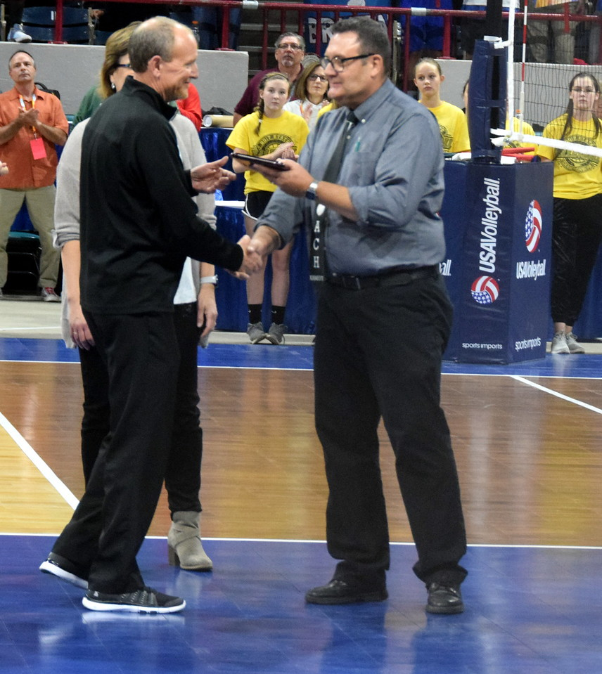 Coach Doug Kamery receives the Horizon Award before the championship game.