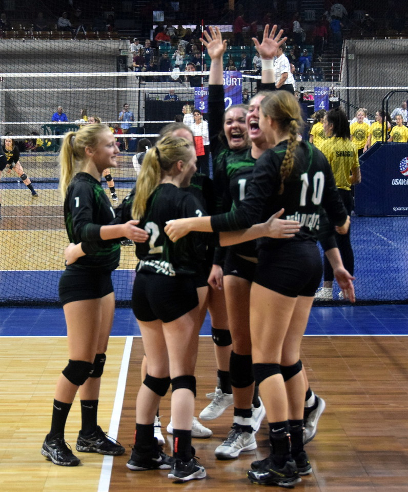 The Fleming Wildcats celebrate after a kill.