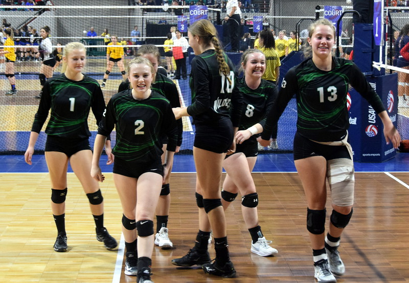 The Fleming Wildcats come off the court after a set win in the 1A state tournament at the Denver Coliseum.