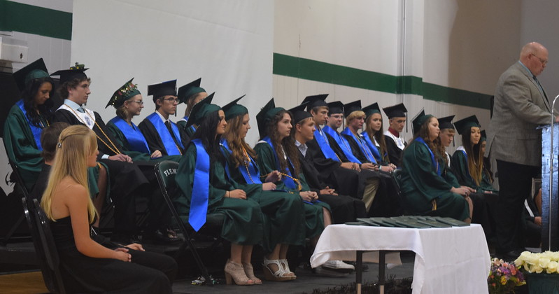 Fleming High School graduates listen as Superintendent Steve McCracken welcomes guests to the commencement ceremony Sunday, May 14, 2017.