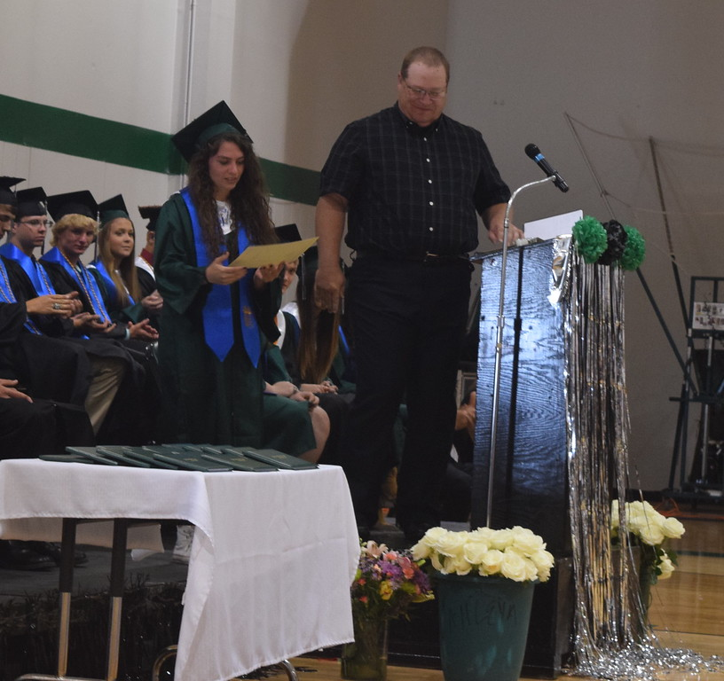 . Kalyn Serrato receives the Katherine Chaney Memorial Scholarship from Dale Chaney at Fleming High School\'s commencement ceremony Sunday, May 14, 2017.