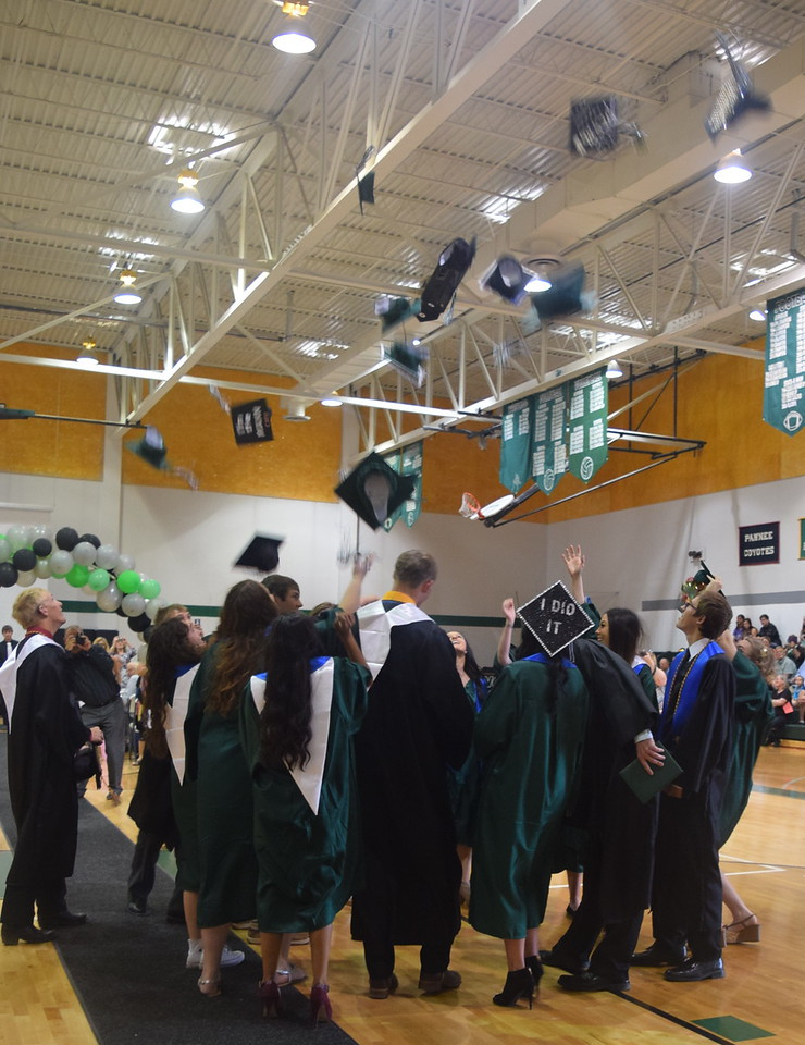 Fleming High School's newest graduates celebrate at the end of the commencement ceremony Sunday, May 14, 2017.