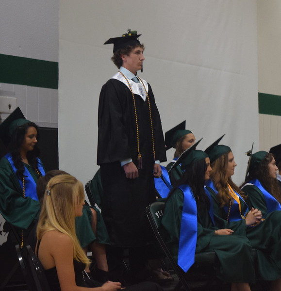 Trae Etl stands as he is recognized during Fleming High School's commencement ceremony Sunday, May 14, 2017.