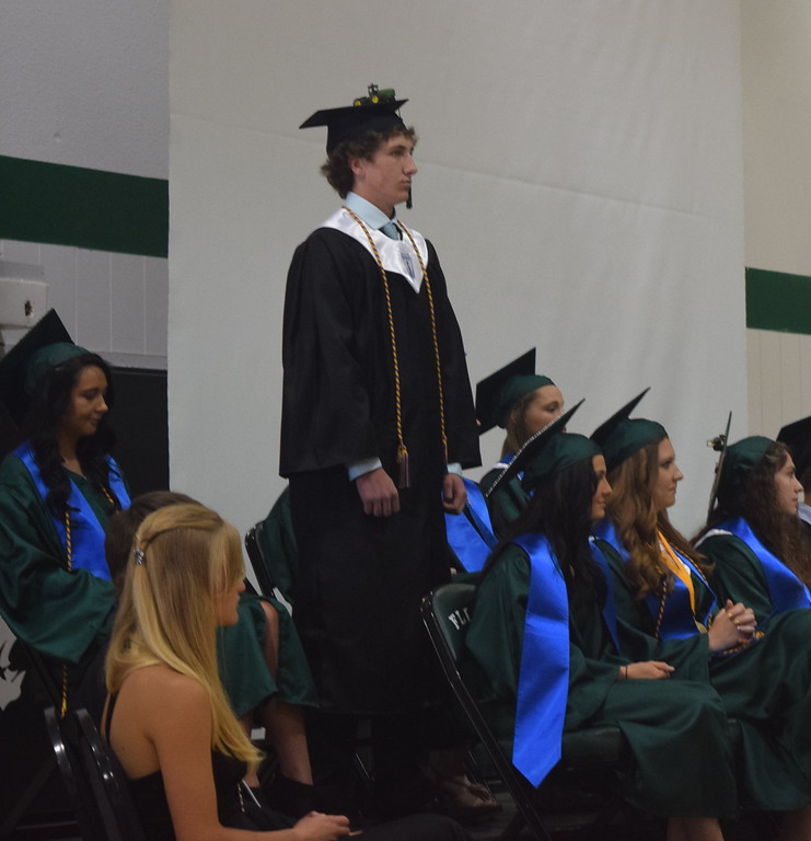 . Trae Etl stands as he is recognized during Fleming High School\'s commencement ceremony Sunday, May 14, 2017.