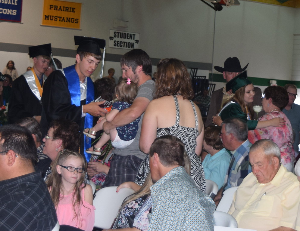 . Graduates hand out flowers to their family and friends during Fleming High School\'s commencement ceremony Sunday, May 14, 2017.