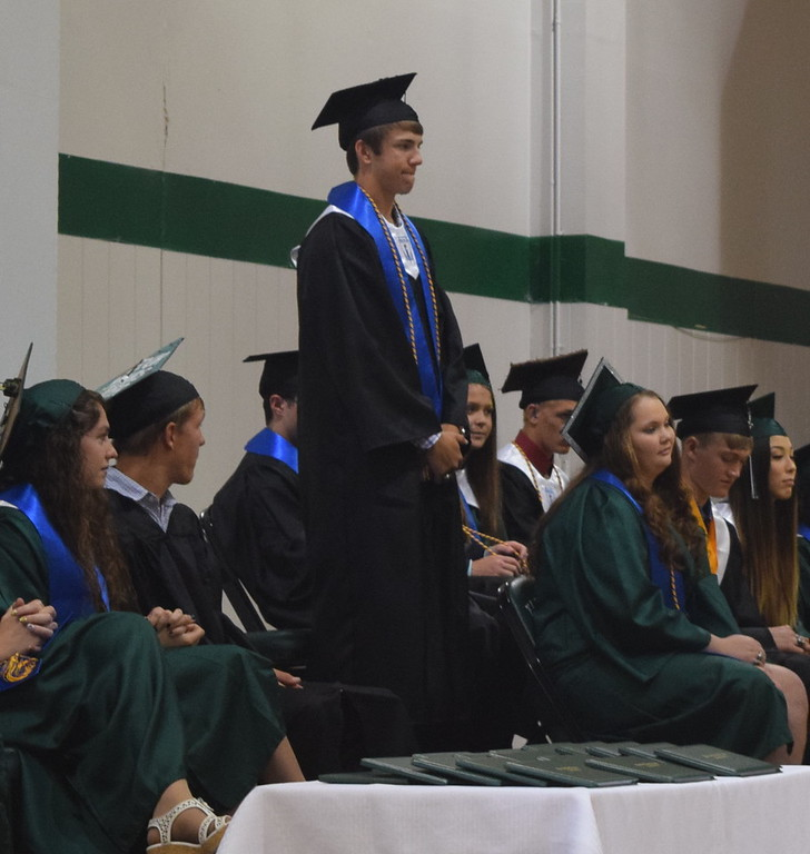 . Jaxon King stands as he is recognized during Fleming High School\'s commencement ceremony Sunday, May 14, 2017.
