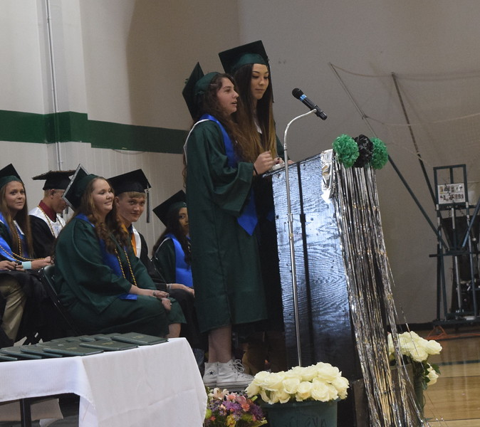 Kalyn Serrato and Eleanor Vogel share memories of their classmates during Fleming High School's commencement ceremony Sunday, May 14, 2017.