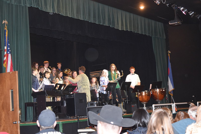 Band students prepare to perform, under the direction of Jeri Anderson, at Fleming School's 5-12th grade Christmas concert Tuesday, Dec. 13, 2016.