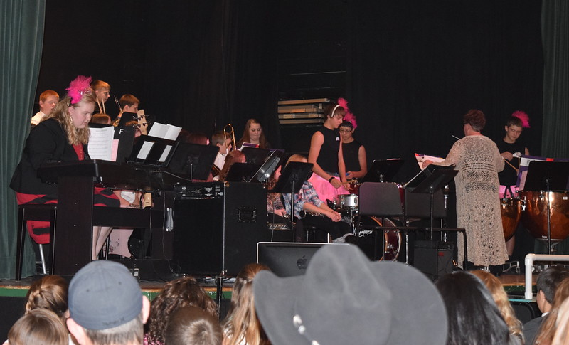 """The high school percussion ensemble, dressed in their best tutus, perform """"Dance of the Swans,"""" under the direction of Jeri Anderson, at Fleming School's 5-12th grade Christmas concert Tuesday, Dec. 13, 2016."""