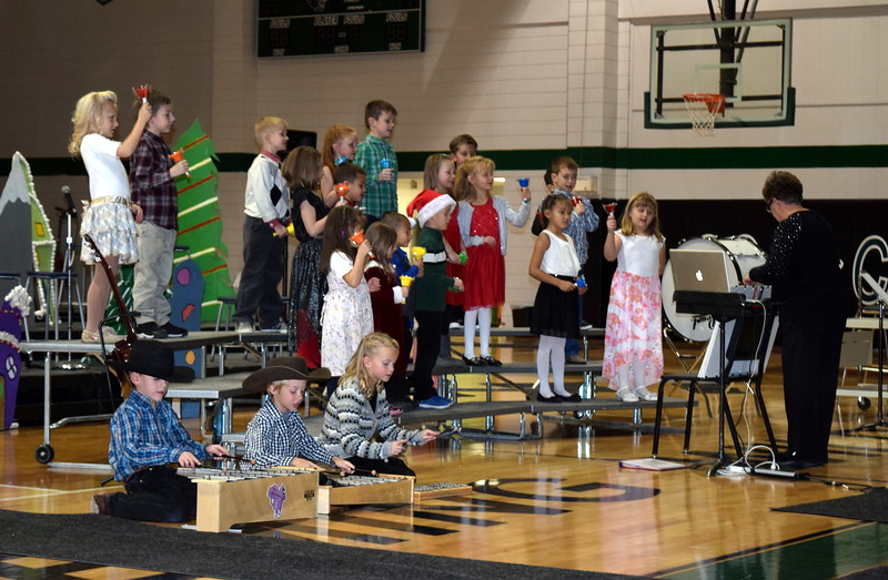 "Kindergarten and first grade students perform ""Chime In,"" under the direction of Jeri Anderson, during Fleming Elementary's holiday concert, Thursday, Dec. 15, 2016."