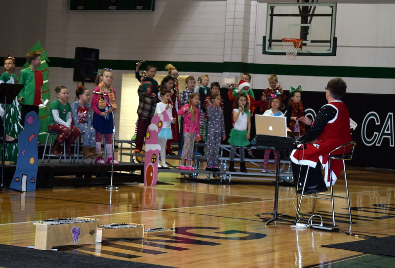 "Fleming Elementary second through fourth graders sing ""This Magic Season"" during the school's Reader's Theatre presentation of ""How the Grinch Stole Christmas"" Thursday, Dec. 15, 2016."