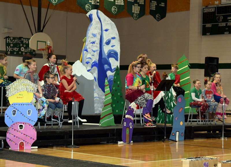 "Elementary and high school readers tell the story of ""How the Grinch Stole Christmas"" during a Reader's Theatre presentation by second through fourth graders at Fleming School Thursday, Dec. 15, 2016."