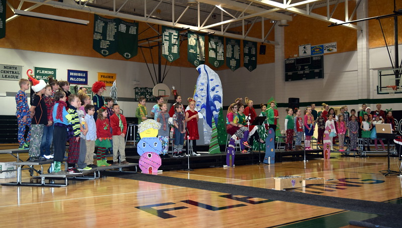 "Students dressed as characters from Whoville sing ""Trim Up the Tree"" during Fleming School's second through fourth grade Reader's Theatre presentation of ""How the Grinch Stole Christmas,"" directed by Jeri Anderson, Thursday, Dec. 15, 2016."