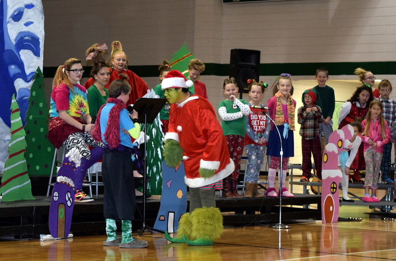 "Students take turns telling the Grinch (Darian Wilkening) how mean and terrible he is as they sing ""You're a Mean One, Mr. Grinch"" during Fleming Elementary's Reader's Theatre presentation of ""How the Grinch Stole Christmas"" Thursday, Dec. 15, 2016."