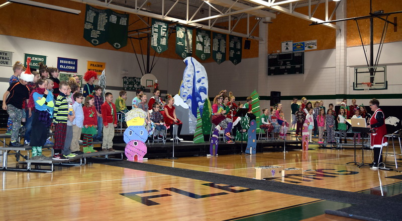 "Dressed in their best Whoville outfits second through fourth graders sing ""Welcome Christmas"" at Fleming Elementary's Reader's Theatre presentation of ""How the Grinch Stole Christmas"" Thursday, Dec. 15, 2016,"