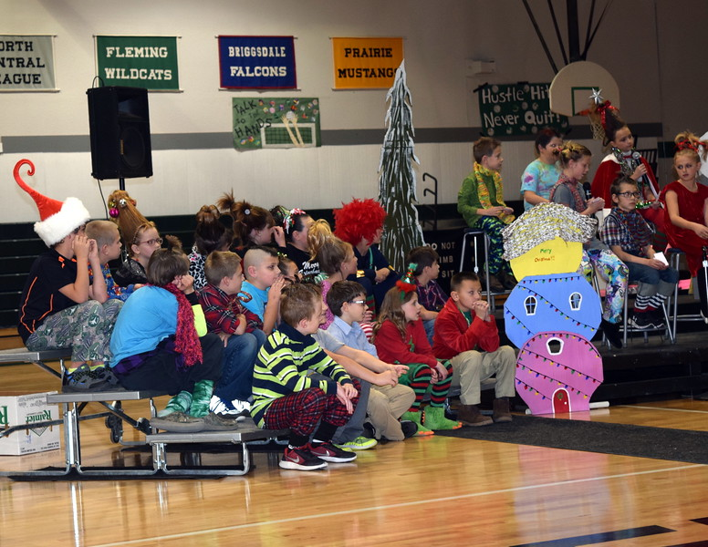 "Second through fourth graders listen as the Grinch prepares to steal Christmas from the residents of Whoville during Fleming School's Reader's Theatre presentation of ""How the Grinch Stole Christmas"" Thursday, Dec. 15, 2016."