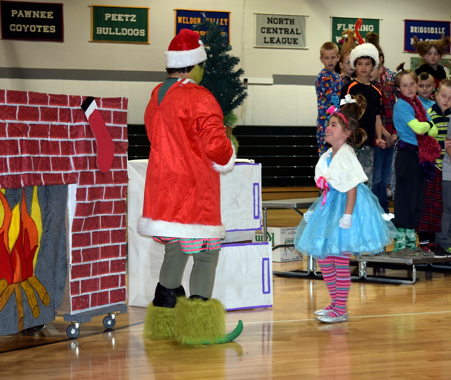 "Cindy Lou Who asks the Grinch, who is disguised as Santa Claus, why he's taking her family's Christmas tree, during Fleming School's second through fourth grade Reader's Threatre presentation of ""How the Grinch Stole Christmas,"" Thursday, Dec. 15, 2016."