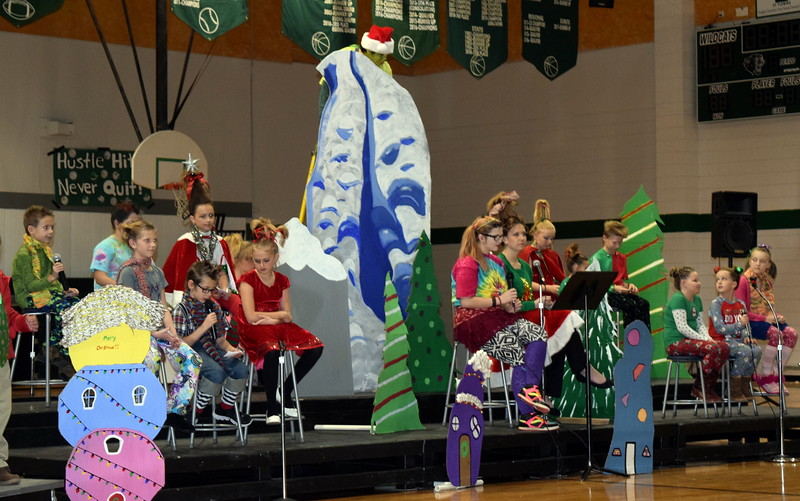 "The Grinch, played Fleming alumni Darian Wilkening, looks down on Whoville from Mount Crumpit, during Fleming School's second through fourth grade Reader's Threatre presentation of ""How the Grinch Stole Christmas,"" directed by Jeri Anderson, Thursday, Dec. 15, 2016."