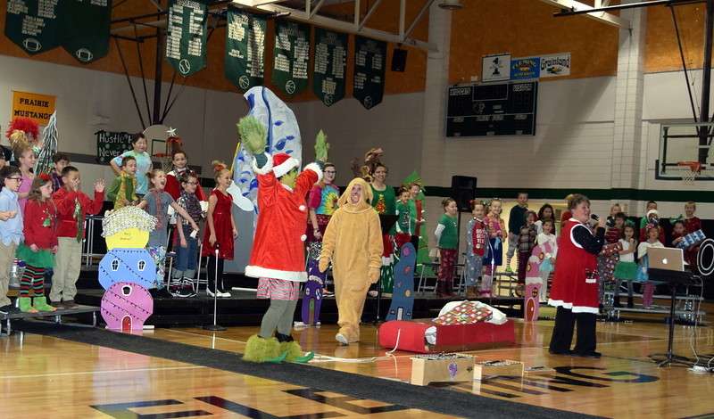 "The Grinch (Darian Wilkening) and his dog, Max (Bailey Chintala), return the Christmas presents they'd stolen to the town of Whoville at the conclusion of Fleming Elementary's Reader's Theatre presentation of ""How the Grinch Stole for Christmas"" Thursday, Dec. 15, 2016."