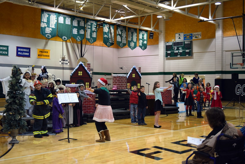 """Second through fourth grade students sing the opening number, """"Once on a Housetop,"""" under the direction of Jeri Anderson, during Fleming Elementary's production of """"Once on a Housetop"""" Monday, Dec. 11, 2017."""