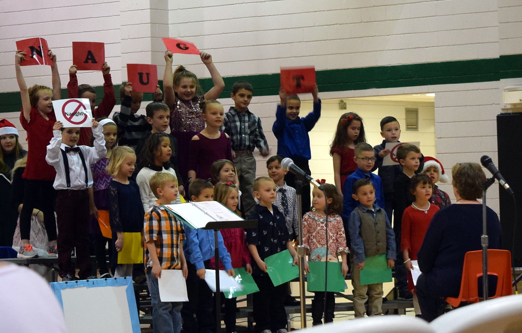 ". Kindergarten and first grade students perform ""Nice, Not Naughty,\"" under the direction of Jeri Anderson, at Fleming Elementary\'s holiday concert Monday, Dec. 11, 2017."