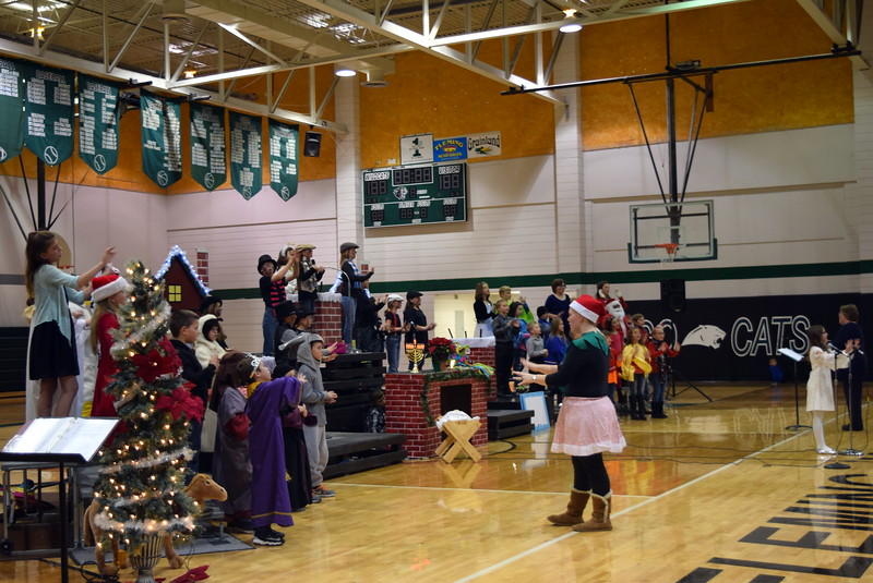 """Fleming Elementary second through fourth graders perform """"Song of Peace"""" during their production of """"Once on a Housetop"""" Monday, Dec. 11, 2017."""