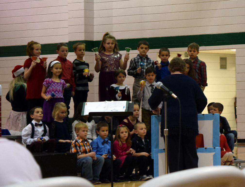 ". Kindergarten and first graders perform ""Ding Dong Ding,\"" under the direction of Jeri Anderson, at Fleming Elementary School\'s holiday concert Monday, Dec. 11, 2017."