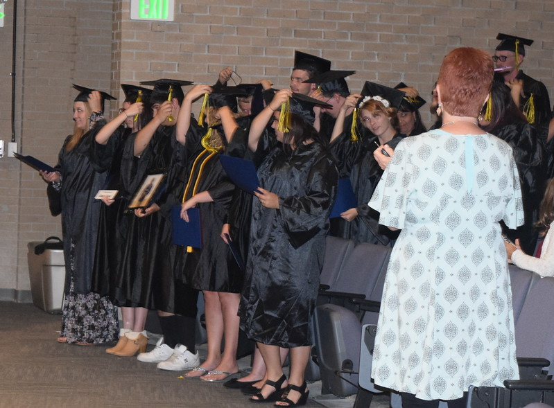 Graduates flip their tassels at the conclusion of the GED Graduation Celebration Saturday, June 17, 2017.