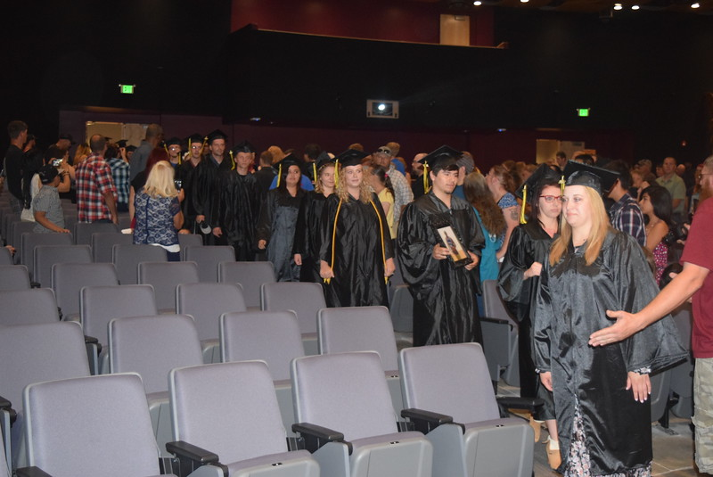 Graduates make their way into the Dorothy Corsberg Theatre at the start of Northeastern Junior College's GED Graduation Celebration Saturday, June 17, 2017.
