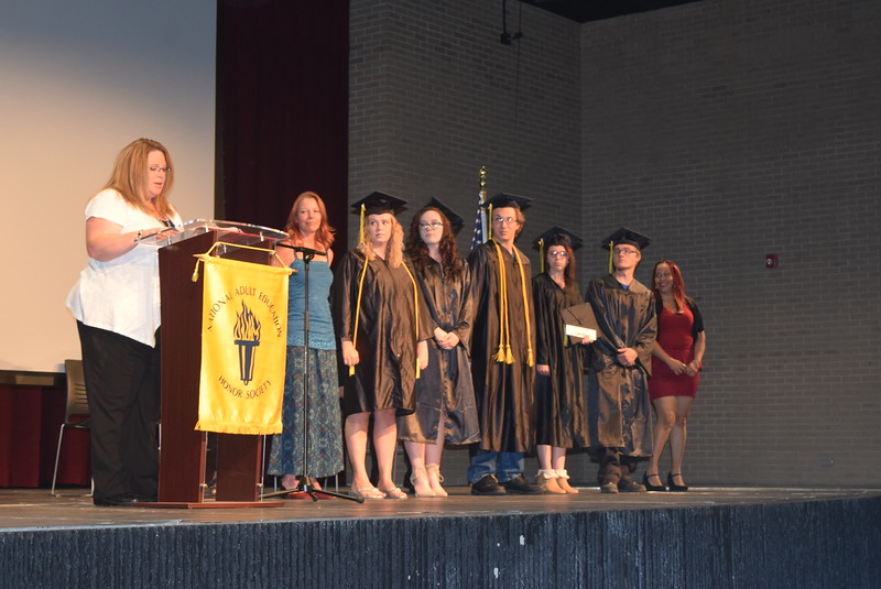 Krysta Kenney, college and career navigaor recognizes GED students who have obtained an internship, Aileen Miranda, left, and Jenna Richards, third from left, at the GED Graduation Celebration Saturday, June 17, 2017. Also on stage are Nicole Capps, scholarship recipient for NJC's certified nurses aid program and honor roll student; Jenna Richards, who received assistance from Sterling Workfoce Center; Hawk Turner, honor roll student who received assistance from SWC, Carolyn Waller, honor roll Brady Hayes, who received assistance from SWC; and Elizabeth Carreon, scholarship recipient for NJC's certified nurses aid program.