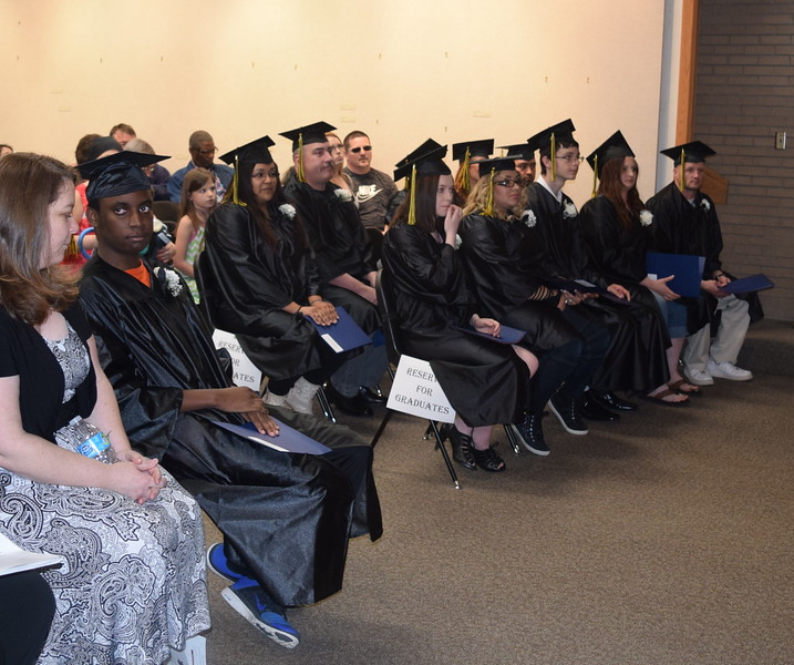 Graduates listent to remarks at the GED Graduation Celebration Saturday, May 14, 2016.