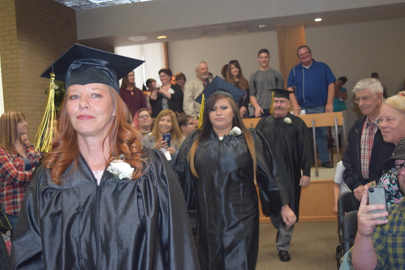 Graduates makes their way into Tennant Art Gallery for the GED Graduation Celebration Saturday, May 14, 2016.