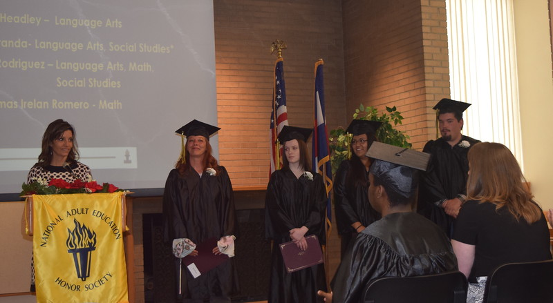 Yvonne Avila Draxler recognizes GED Honores Scores graduates, from left;  Aileen Miranda, Veronica Headley, Jackliyn Rodriquez and Sean Thomas Irelan Romero, during the GED Graduation Celebration Saturday, May 14, 2016.