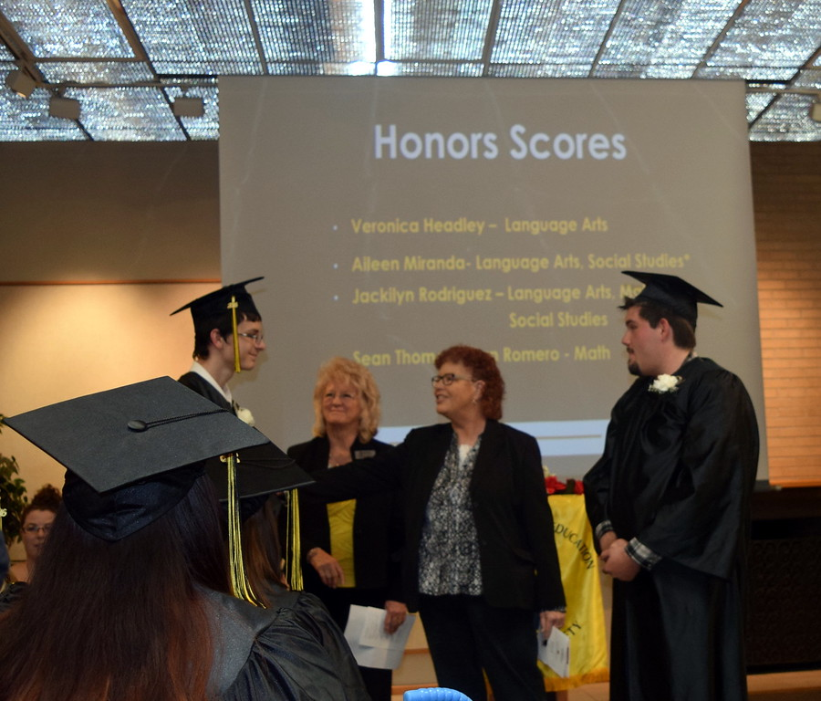 Ginger Allen, second from left,  and Jamie McArthur, of Sterling Workforce Center, recognize scholarship recipients Patrick Cook, left, and Sean Thomas Irelan Romero GED Graduation Celebration Saturday, May 14, 2016.