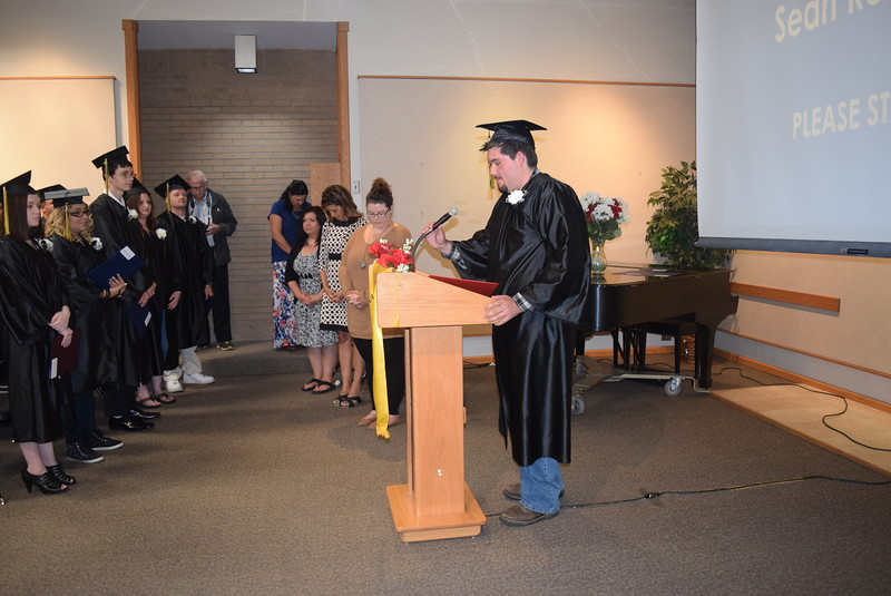 Sean Romero gives the benediction at the end of the GED Graduation Celebration Saturday, May 14, 2016.