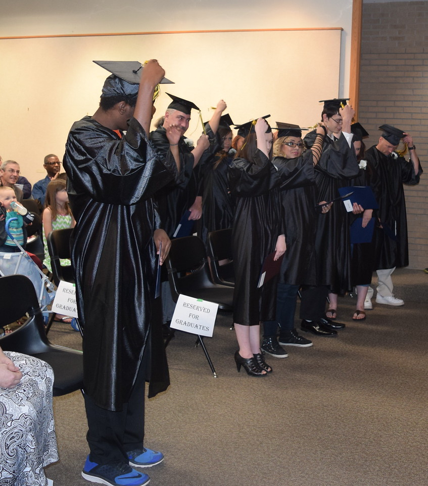 Graduates flip their tassels at the close of the GED Graduation Celebration Saturday, May 14, 2016.