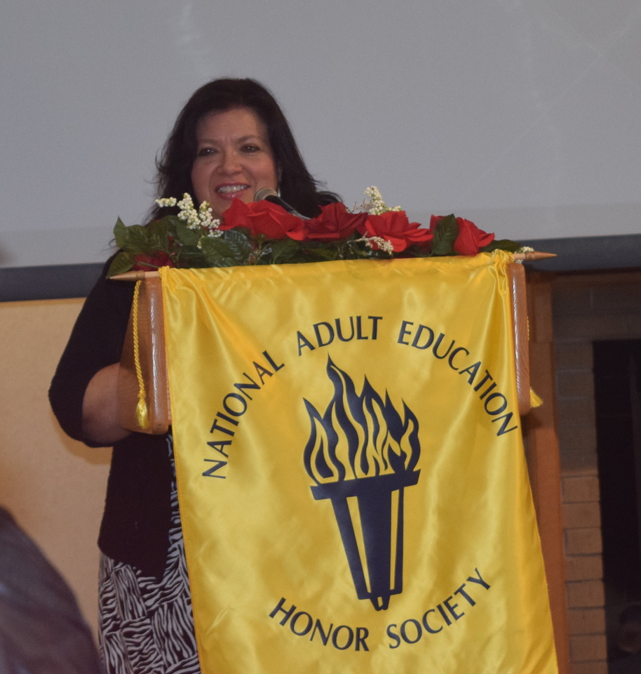 Leslie Helfer, adult basid educator director at Northeastern Junior College,  welcomes guests to the GED Graduation Celebration Saturday, May 14, 2016.